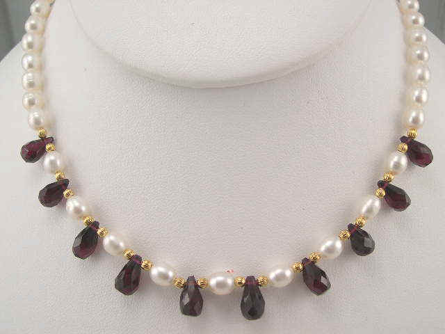 pearl with garnet tear drop bead